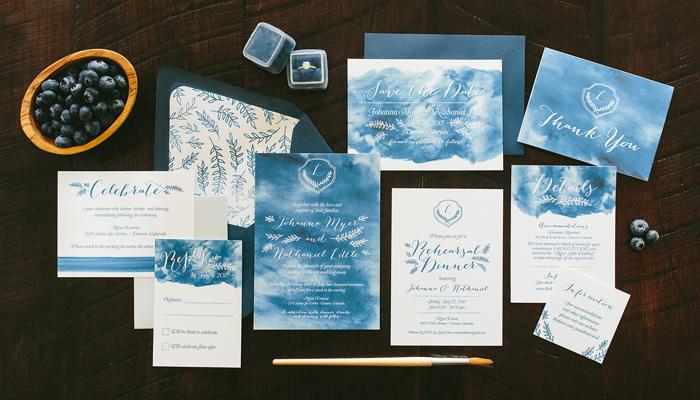 watercolor background wedding invitation with crest