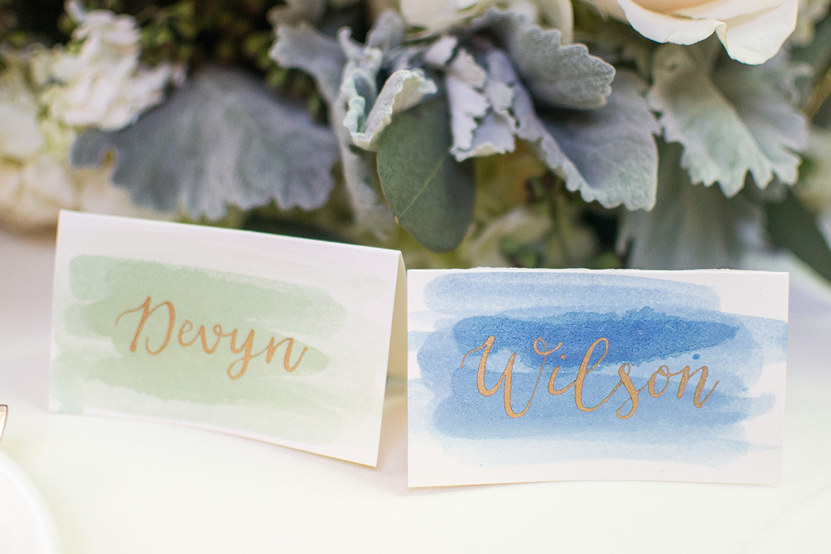 watercolor wash place cards with gold calligraphy