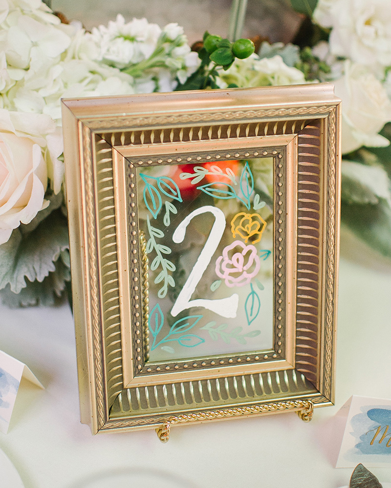 gold frame painted glass table numbers