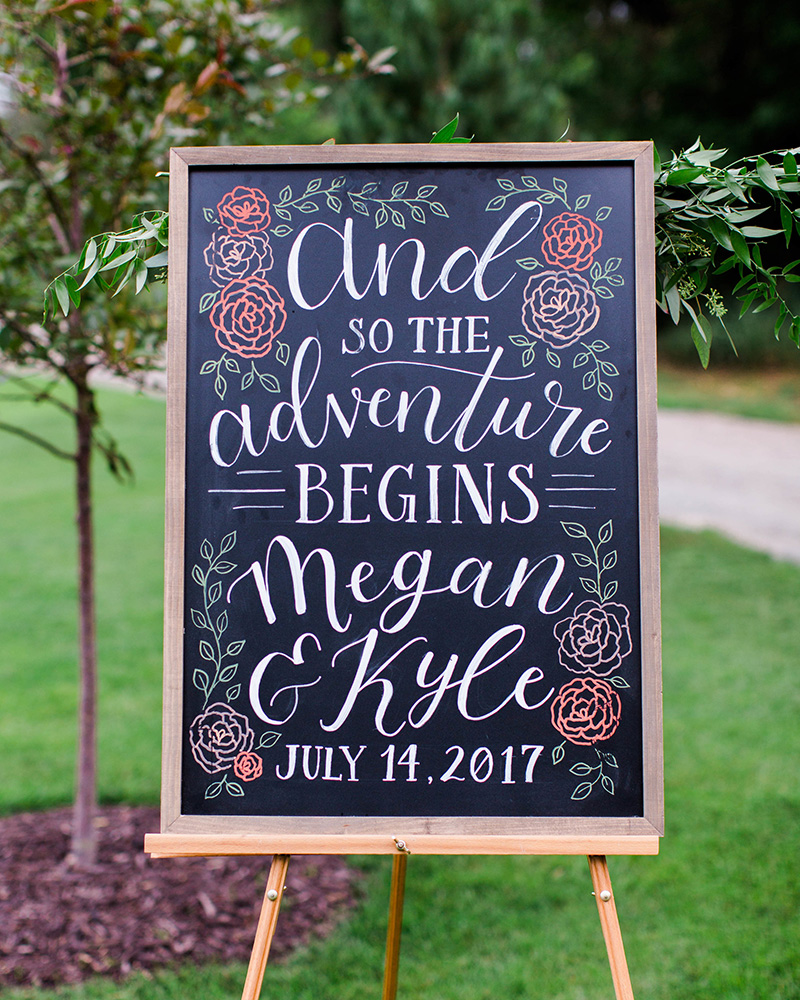 colorful chalkboard wedding welcome sign and so the adventure begins