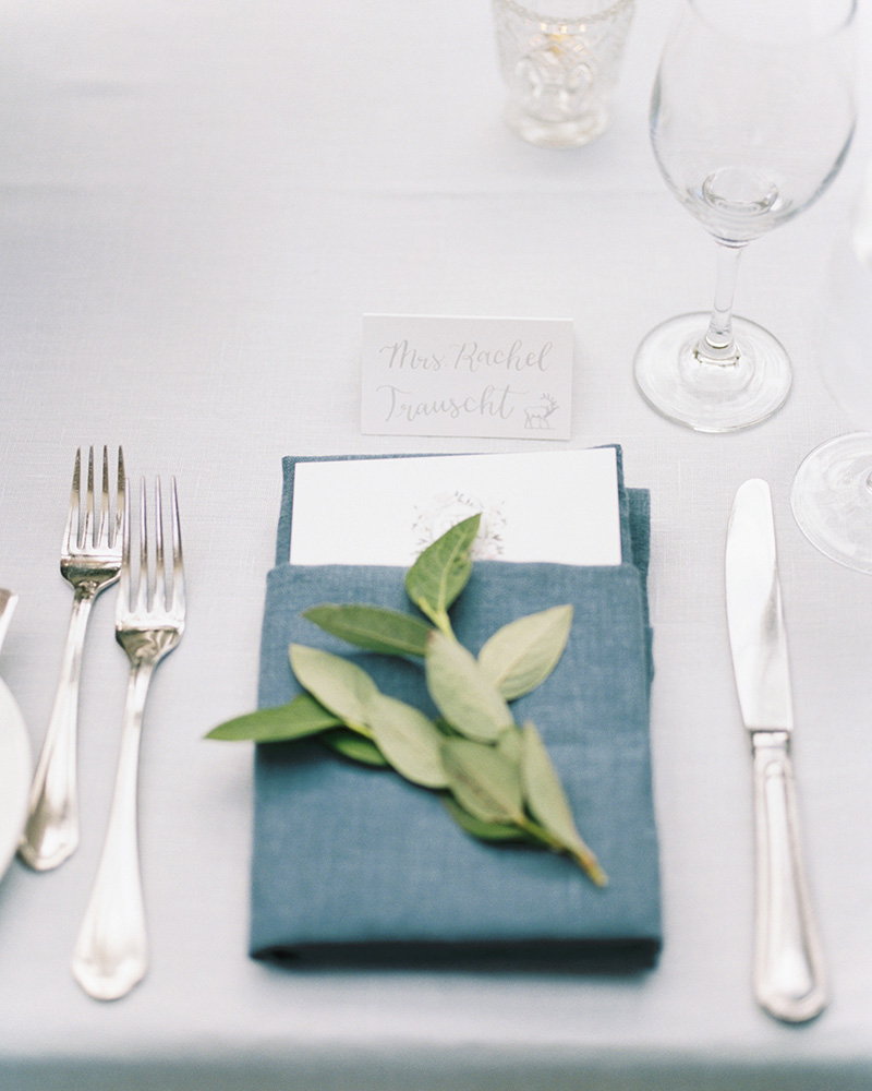 soft gray calligraphy place card with meal icon