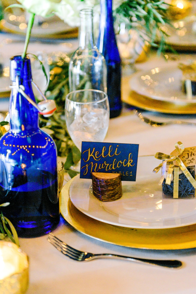 gold on navy escort cards
