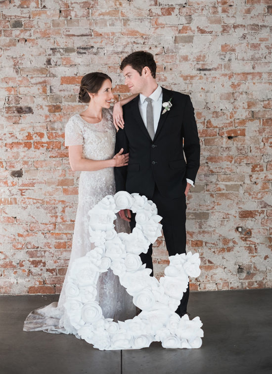 paper flower ampersand wedding decor