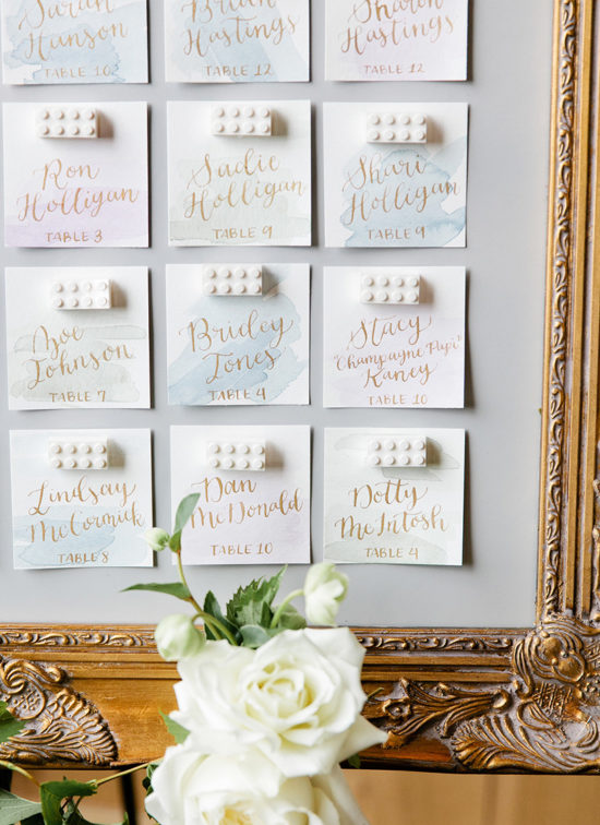 gold calligraphy watercolor wash escort card disaply with legos