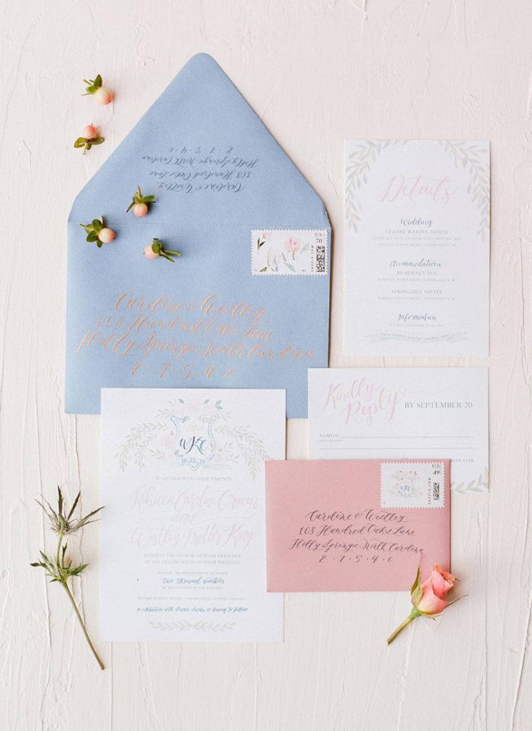 soft romantic custom wedding invitations with monogram crest and laurels, calligraphy