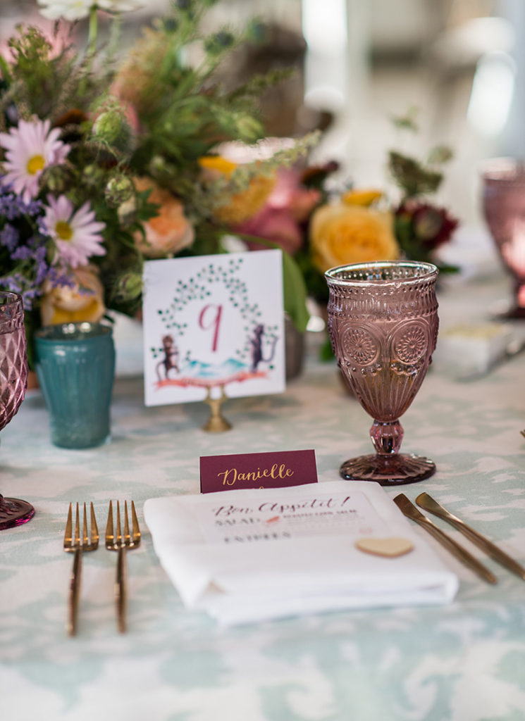 Fun, Eclectic Wedding with Monogram Crest table number and calligraphy place cards on burgundy