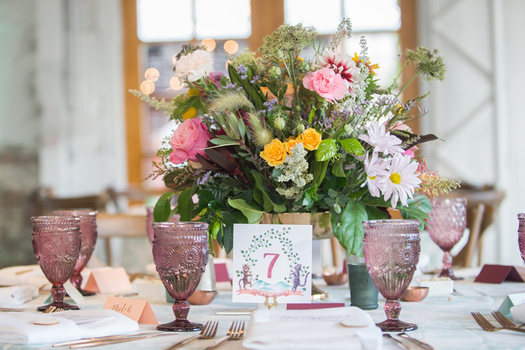 colorful tablescape with custom watercolor crest table numbers