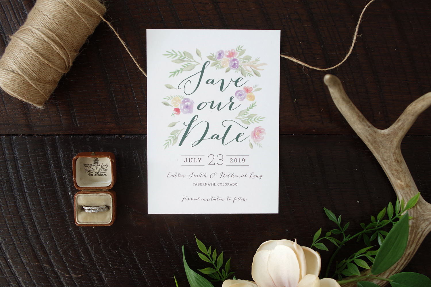 Colorful Rustic Save the Date with painted flowers and antlers